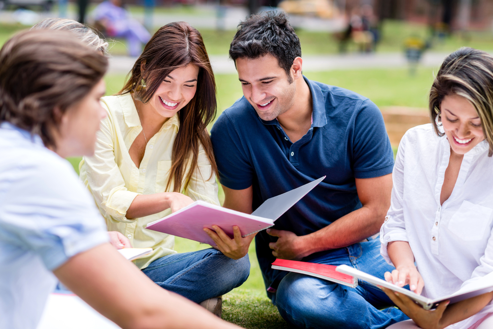 Students studying outside together